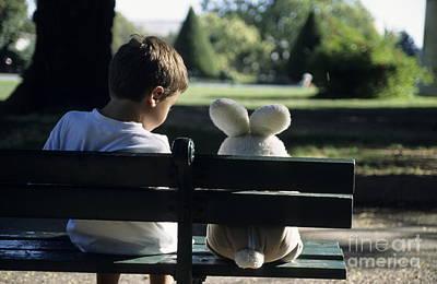 Boy Sitting On Park Bench With Teddy Bear Art Print by Sami Sarkis