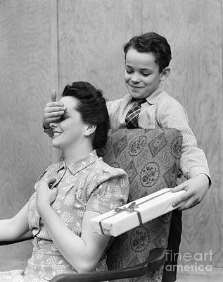 Boy Surprising Mother With Gift Print by H. Armstrong Roberts/ClassicStock