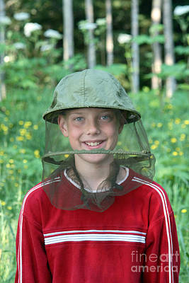 Netting Photograph - Boy With A Bug Net Hat by Ted Kinsman
