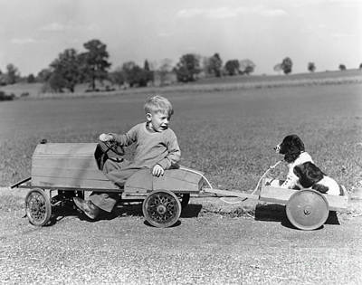 Boy With Canine Cargo, C.1930-40s Art Print