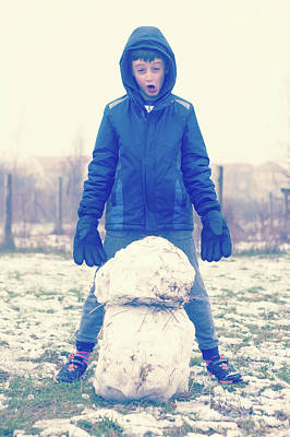 Hoodie Photograph - Boy With Snowman by Tom Gowanlock
