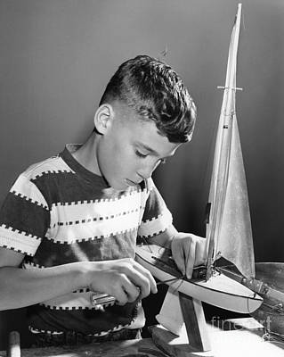 Boy Working On Model Sailboat, C.1950s Print by H. Armstrong Roberts/ClassicStock