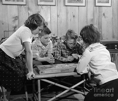 Boys And Girls Playing Board Game Print by H. Armstrong Roberts/ClassicStock