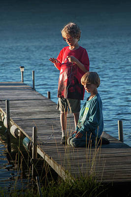 Photograph - Boys On A Wooden Boat Dock In Late Afternoon by Randall Nyhof