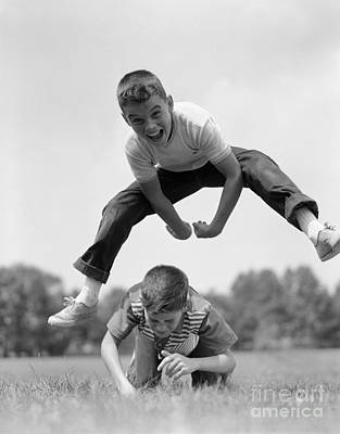 Leap Frog Photograph - Boys Playing Leap Frog, C.1960s by H. Armstrong Roberts/ClassicStock