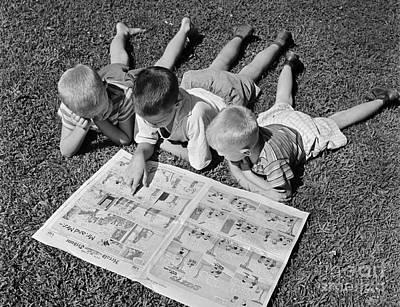 Funnies Photograph - Boys Reading Newspaper Comics, C.1950s by G. Hampfler/ClassicStock