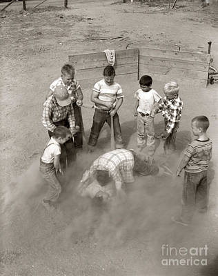 Blue Jeans Photograph - Boys Wrestling In Dust On Sand Lot by D. Corson/ClassicStock