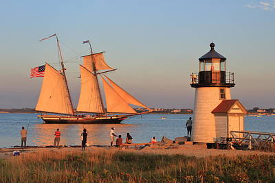 Photograph - Brant Point Lighthouse And Tall Ship Nantucket Harbor by John Burk