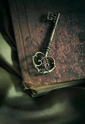 Message Art Photograph - Brass Ornamented Key On Old Brown Book by Jaroslaw Blaminsky