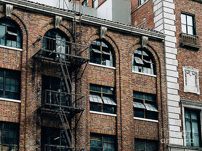 Photograph - Bricks, Windows And Fire Escapes by Merton Allen