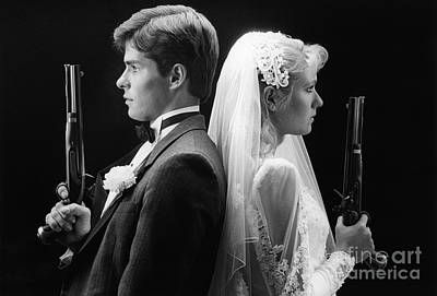 Photograph - Bride And Groom With Dueling Pistols by H. Armstrong Roberts/ClassicStock