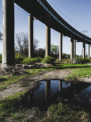 Bridge And Puddle Art Print by Dylan Murphy