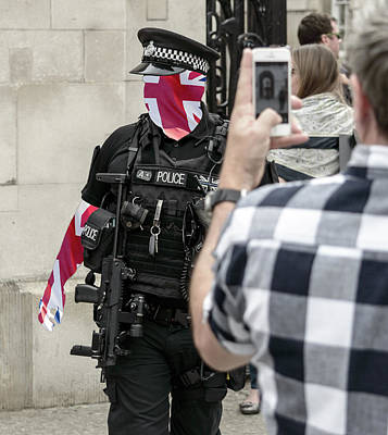 Photograph - British Police Officer Blended With Union Jack Flag by Jacek Wojnarowski