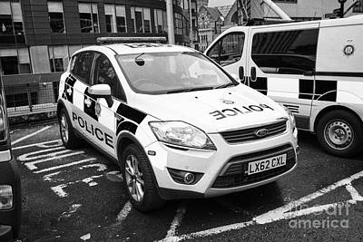 Police Van Photograph - british transport police ford kuga and vehicles Manchester England UK by Joe Fox