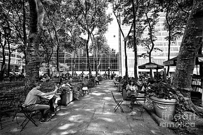 Art Print featuring the photograph Bryant Park Reading by John Rizzuto