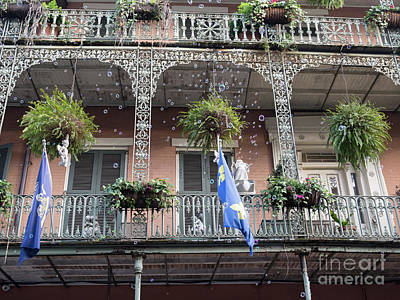 Photograph - Bubbles Blow From An Ornate Balcony In New Orleans At Mardi Gras by Louise Heusinkveld