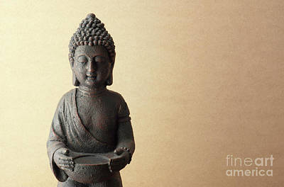 Religious Amulet Photograph - Buddha Statue On Beige Background by Kira Yan