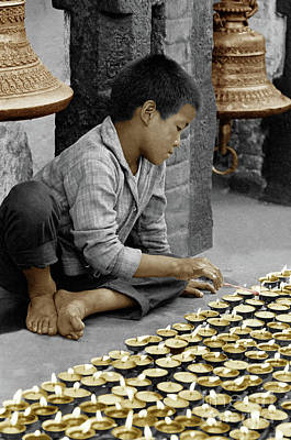 Photograph - Buddhist Boy Lighting Candles - Bodhanath, Nepal by Craig Lovell