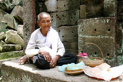 Photograph - Buddhist Nun At Angkor Wat by John Meader