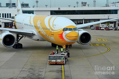 Photograph - Budget Airline Nokscoot Jet Airplane Towed At Bangkok Suvarnabumi Airport Thailand by Imran Ahmed