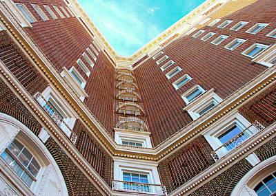 Photograph - Building Meets Blue Sky by Walter E Koopmann