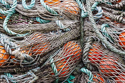 Net Photograph - Bundle Of Fishing Nets And Buoys by Carol Leigh