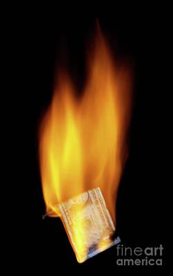 Burning Money Photograph - Burning Money by Roland Magnusson