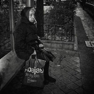 Woman Wall Art - Photograph - Bus Stop Lady #streetphotography by Rafa Rivas