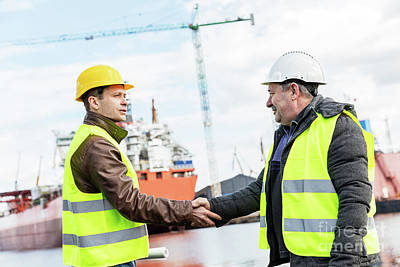 Photograph - Business Handshake In A Shipyard. Shipbuilding Industry by Michal Bednarek