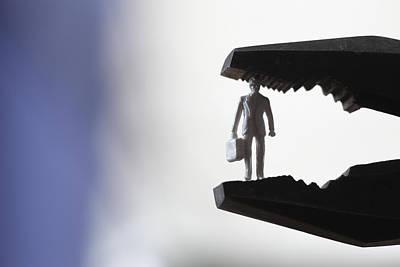 Business Man Under Pressure In Pliers Print by Ulrich Kunst And Bettina Scheidulin