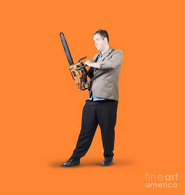 Businessman Holding Portable Chainsaw Print by Jorgo Photography - Wall Art Gallery