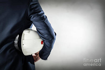 Professional Photograph - Businessman Holding White Safety Helmet. by Michal Bednarek