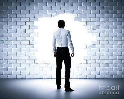 Hole Photograph - Businessman Standing Next To A Hole In A Brick Wall. Light Coming From Outside by Michal Bednarek