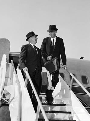 Businessmen Exiting Airplane Art Print