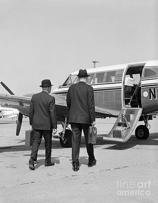 Businessmen Walking To Plane Art Print by H. Armstrong Roberts/ClassicStock