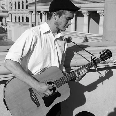 Photograph - Busker by Robert Melvin