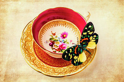 Butterfly Resting On Tea Cup Print by Garry Gay