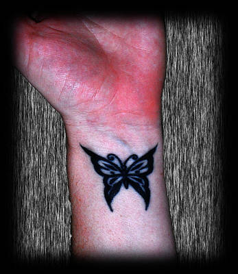 Photograph - Butterfly Tattoos by Amanda Vouglas