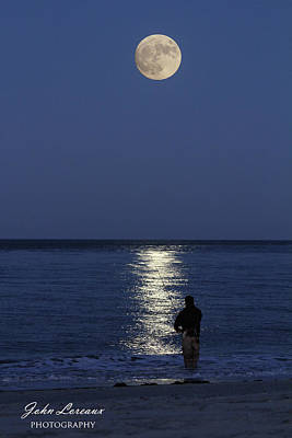 Photograph - By The Light Of The Supermoon by John Loreaux