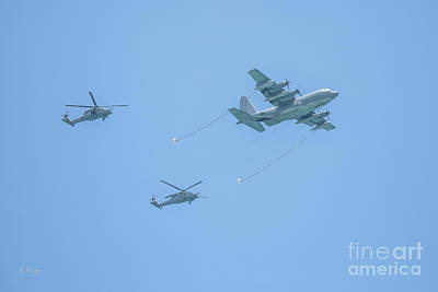 Photograph - A Couple Sikorsky Helicopters About To Join Up On A C-130 Hercules Aircraft by Rene Triay Photography