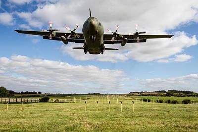 Photograph - C130 Hercules Landing by Ken Brannen