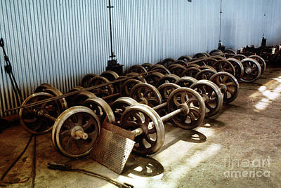 Photograph - Cable Car Wheels, Repair Shop by Wernher Krutein