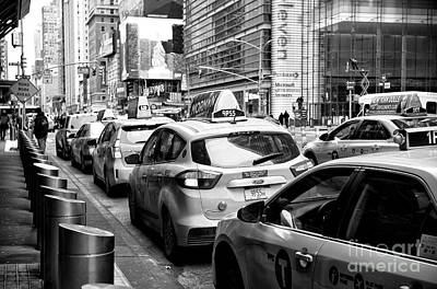 Photograph - Cabs At Port Authority by John Rizzuto