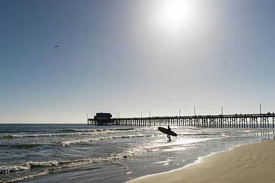Photograph - Californias Favourite Sport - Surfer At The Newport Beach Pier by Georgia Mizuleva