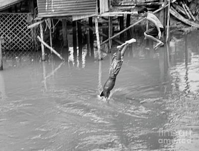 Cambodian 2 Boys Dive  Art Print by Chuck Kuhn