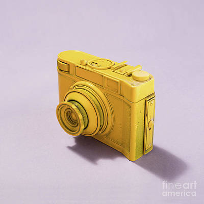 Photograph - Camera Standing On Pastel Pink Background by Michal Bednarek