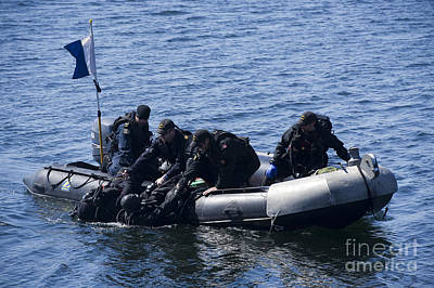 Inflatable Boats Photograph - Canadian Divers Being Helped Aboard by Stocktrek Images