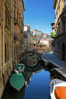 Photograph - Canal With Boats And Blue Water In Lovely Venice Italy by Matthias Hauser