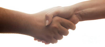 Finance Photograph - Candid Handshake On White Background. Strong Backlight by Michal Bednarek