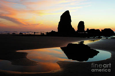 Water Play Photograph - Cannon Beach Sunset by Bob Christopher
